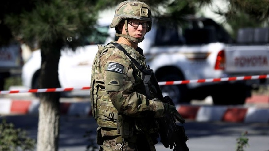 Sept. 16, 2014: A U.S. solider stands guard at the site of a suicide attack near a U.S. military camp in Kabul, Afghanistan. (AP)