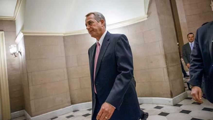 March 3, 3015: House Speaker John Boehner of Ohio walks to the House chamber on Capitol Hill in Washington.