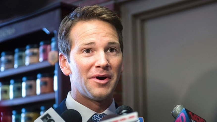 Feb. 6, 2015: Rep. Aaron Schock, R-Ill., answers questions from the media as he returns to Peoria, Ill.