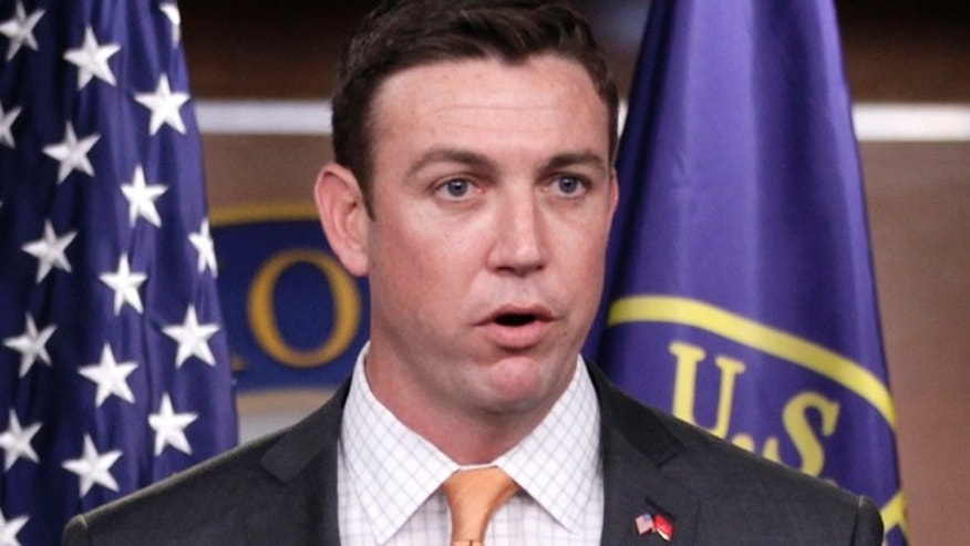 FILE - In this April 7, 2011 file photo, Rep. Duncan Hunter, R-Calif., speaks  during a news conference on Capitol Hill in Washington. (AP Photo/Carolyn Kaster, File)