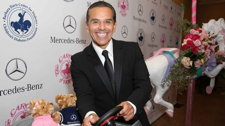 BEVERLY HILLS, CA - OCTOBER 11:  Former Los Angeles mayor Antonio Villaraigosa autographs a Mercedes-Benz car for auction at the Carousel of Hope Ball benefitting Barbara Davis Center for Diabetes on October 11, 2014 in Beverly Hills, California.  (Photo by Chelsea Lauren/Getty Images for Mercedes-Benz)