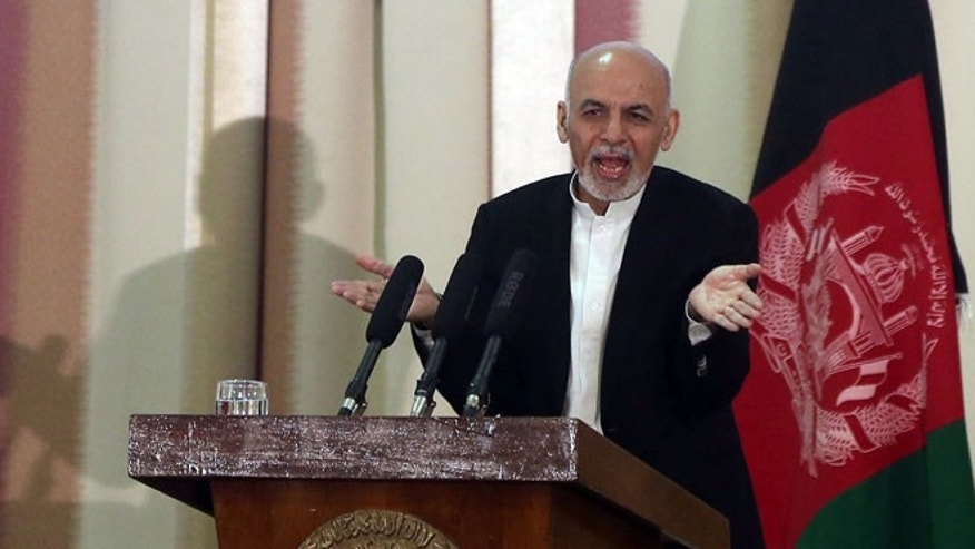 FILE: March 18, 2015: Afghanistan President Ashraf Ghani speaks at a military academy in Kabul, Afghanistan.