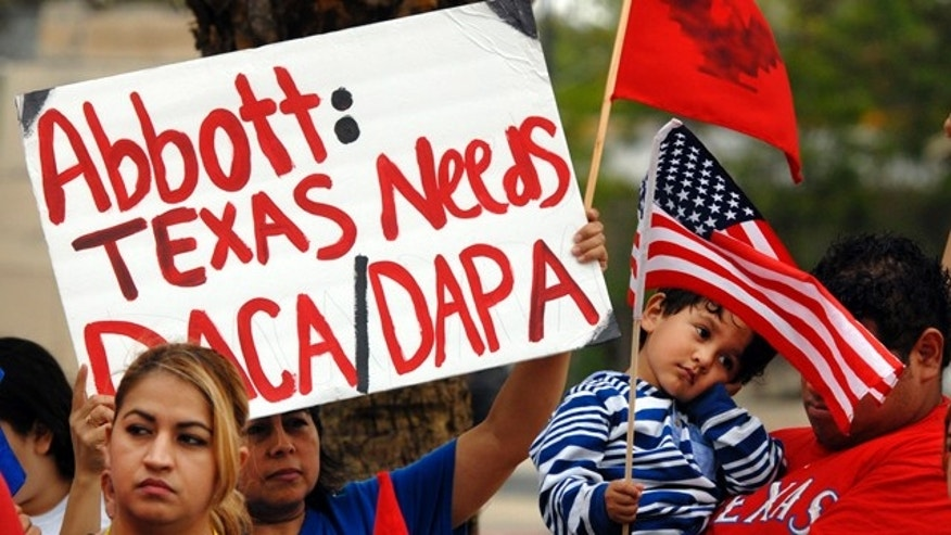 March 19, 2015: Over 100 hundred people demonstrate in favor of President Obama's immigration executive orders in front of the Federal Courthouse in Brownsville, Texas. (AP Photo/Brownsville Herald, Brad Doherty)