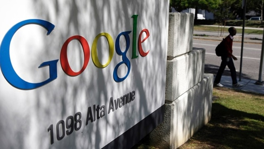 FILE - In this June 5, 2014 file photo, a man walks past a Google sign at the company's headquarters in Mountain View, Calif. (AP Photo/Marcio Jose Sanchez, File)