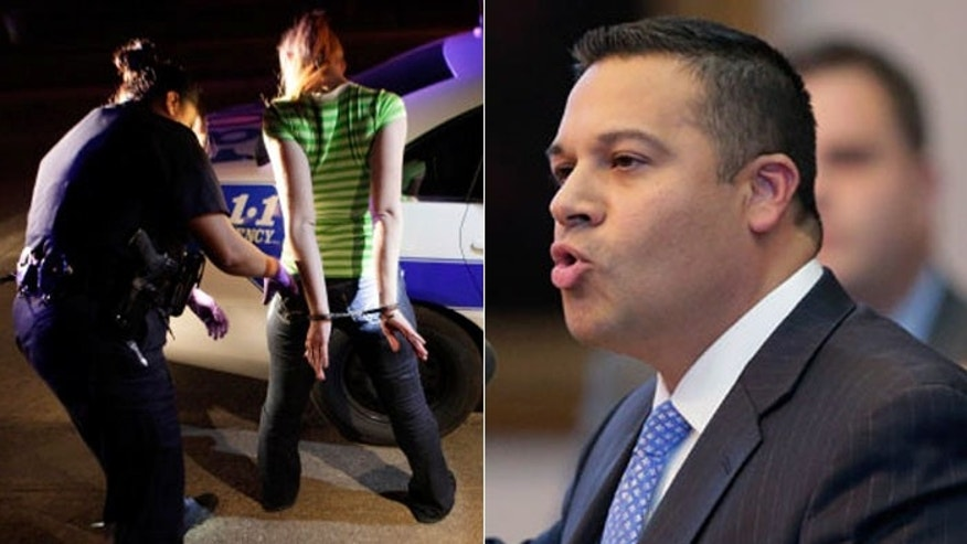 "Texas state lawmaker Jason Villalba, (r.), wants to establish a ""buffer zone"" to keep people away from police as they do their work, as seen above, in photo of Dallas police arresting a prostitution suspect. (AP)"