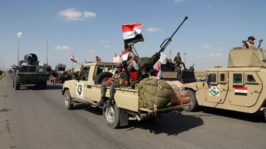 March 26, 2015: Iraqi security forces prepare to attack Islamic State positions in Tikrit.