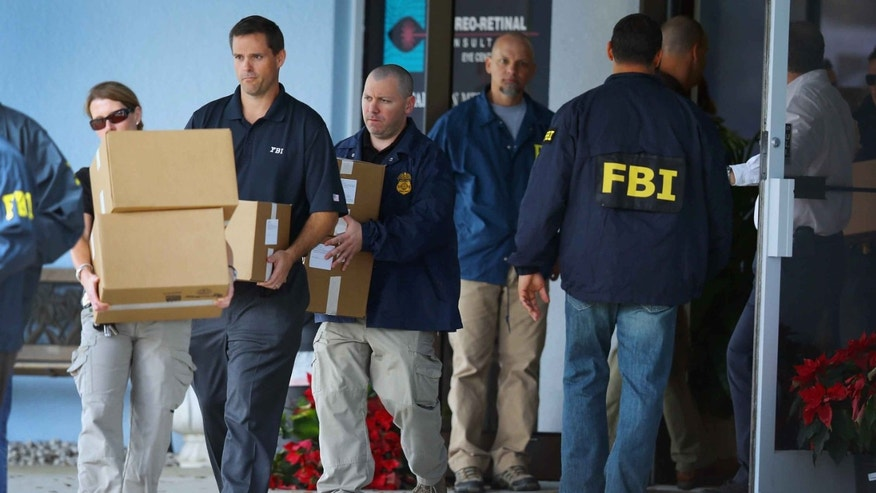 FBI agents carry out boxes as law enforcement officials investigate Dr. Salomon Melgen on January 30, 2013 in West Palm Beach, Florida.