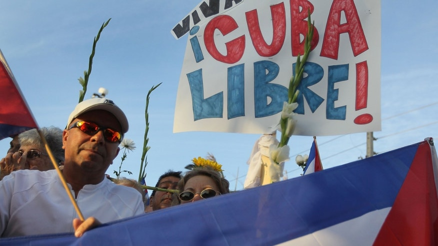 People show their support for an activist group in Cuba.