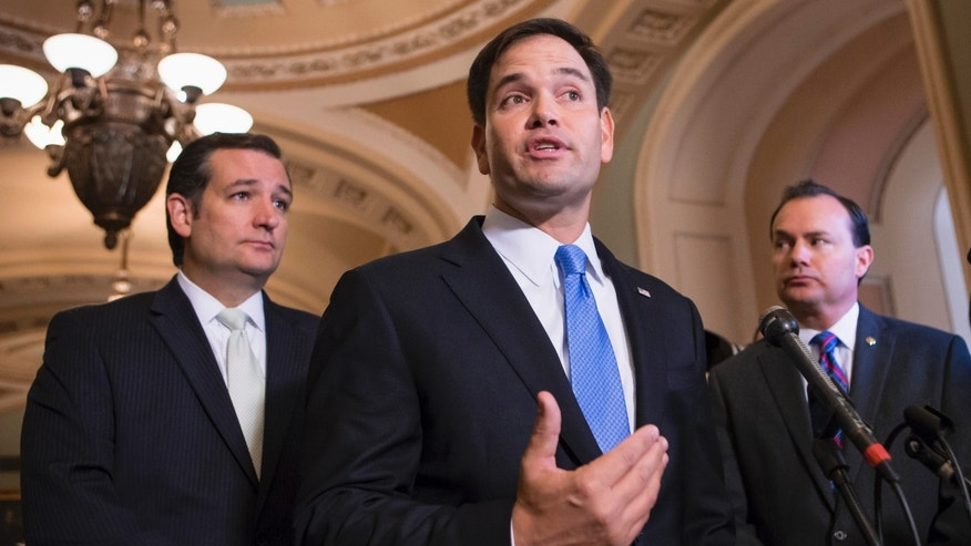 Sen. Marco Rubio, R-Fla., center, accompanied by Sen. Ted Cruz, R-Texas, left, and Sen. Mike Lee, R-Utah.