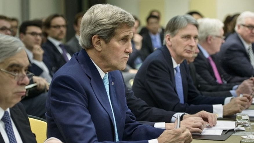 March 31, 2015: U.S. Secretary of State John Kerry, second left, U.S. Secretary of Energy Ernest Moniz, left, British Foreign Secretary Philip Hammond, center, Russian Deputy Foreign Minister Sergei Ryabkov, second right, and German Foreign Minister Frank Walter Steinmeier wait for the start of a meeting on Iran's nuclear program with other officials from France, China, the European Union and Iran at the Beau Rivage Palace Hotel in Lausanne, Switzerland.