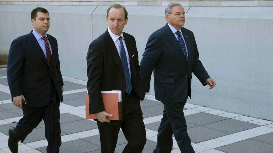 U.S. Sen. Bob Menendez, right, arrives at Newark federal court, Thursday, April 2, 2015, in Newark, N.J.