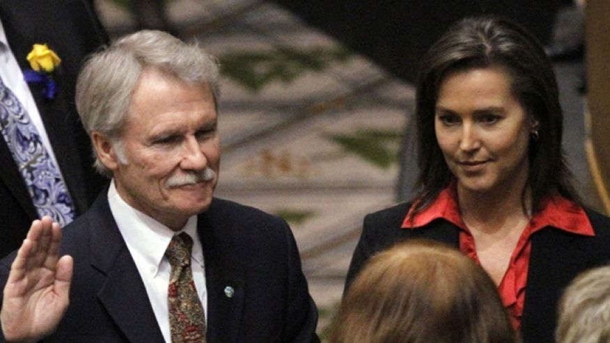 Jan. 10, 2011: Oregon Gov. John Kitzhaber, Democrat, is sworn in with financee Cylvia Hayes at his side. Salem, Oregon.