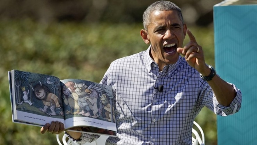 "April 6, 2015: President Obama reads ""Where the Wild Things Are"" by Maurice Sendak, during the White House Easter Egg Roll on the South Lawn of the White House is Washington."