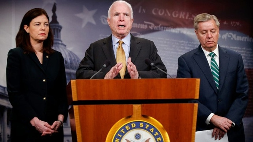 March 26, 2015: Senate Armed Service Committee Chairman Sen. John McCain, R-Ariz., center, accompanied by fellow committee members, Sen. Kelly Ayotte, R-N.H., left, and Sen. Lindsey Graham, R-S.C., speaks during a news conference on Capitol Hill in Washington to talk about  the situation in Yemen. (AP Photo/Andrew Harnik)