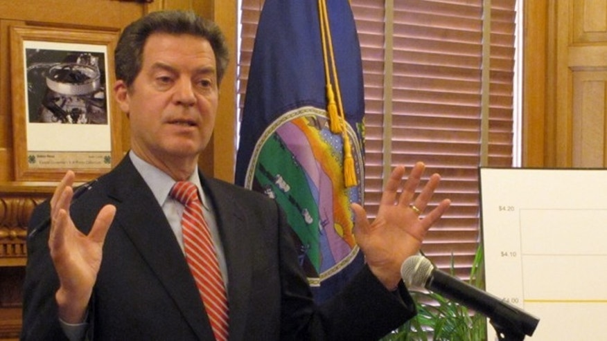 April 2, 2015: Kansas Gov. Sam Brownback answers questions from reporters about pension issues during a news conference at the Statehouse in Topeka, Kan.