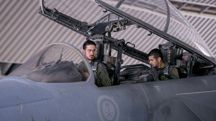 FILE - In this file photo released Sept. 24, 2014 by the official Saudi Press Agency, Saudi pilots sits in the cockpit of a fighter jet as part of U.S.-led coalition airstrikes on Islamic State militants and other targets in Syria, in Saudi Arabia. (AP Photo/Saudi Press Agency, File)
