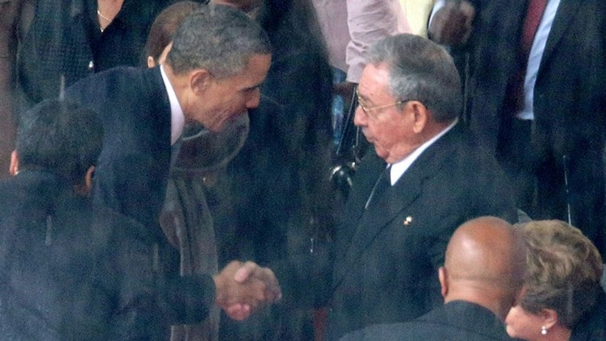 Obama and Castro during the official memorial service for former South African President Nelson Mandela December 10, 2013.