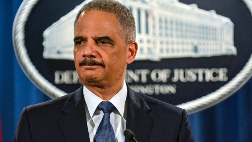 Mar. 4, 2015: U.S. Attorney General Eric Holder addresses reporters in Washington. (Reuters)