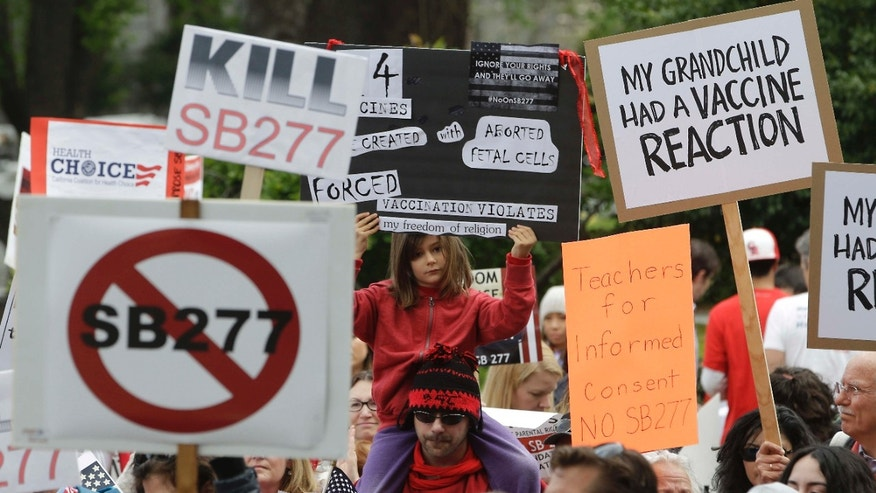 April 8, 2015: Protesters rally against a measure requiring California schoolchildren to get vaccinated at the Capitol in Sacramento, Calif.