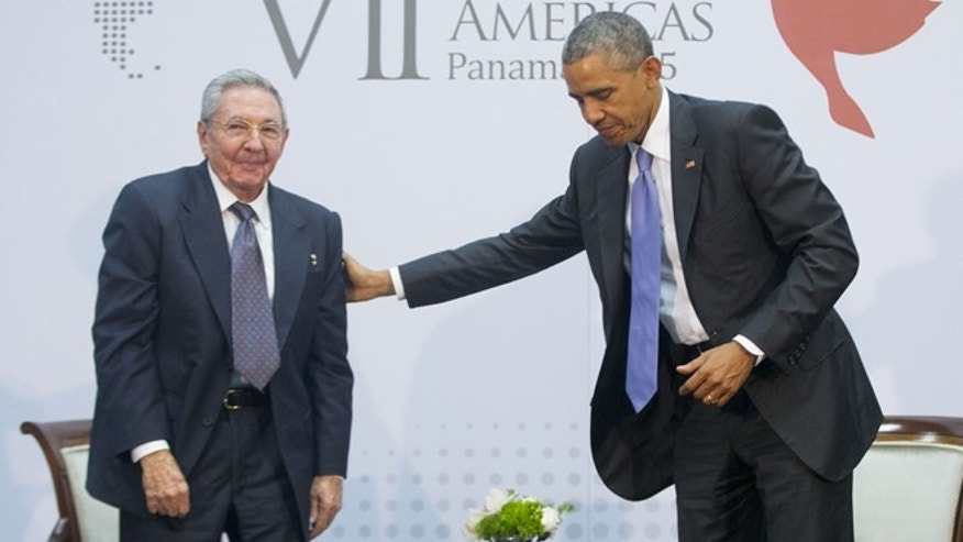 US President Barack Obama with Cuban President Raul Castro during their meeting at the Summit of the Americas in Panama City, Panama, Saturday, April 11, 2015.  The leaders of the United States and Cuba held their first formal meeting in more than half a century on Saturday, clearing the way for a normalization of relations that had seemed unthinkable to both Cubans and Americans for generations.  (AP Photo/Pablo Martinez Monsivais)