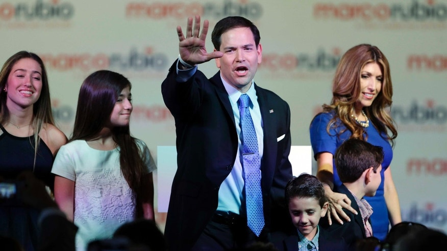 Florida Sen. Marco Rubio waves to the crowd after announcing that he will be running for the Republican presidential nomination during a rally at the Freedom Tower, Monday, April 13, 2015, in Miami. Rubio is joined by his wife Jeanette, right, and their four children, from left, Amanda, Daniella, Dominic and Anthony. (AP Photo/Wilfredo Lee)
