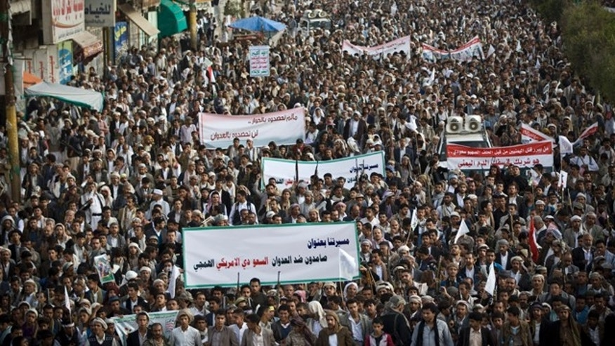 April 10, 2015: Shiite rebels, known as Houthis, gather during a protest against Saudi-led airstrikes in Sanaa, Yemen. The banner at the front reads: 'Steadfast against the savage Saudi American aggression.' (AP Photo/Hani Mohammed)