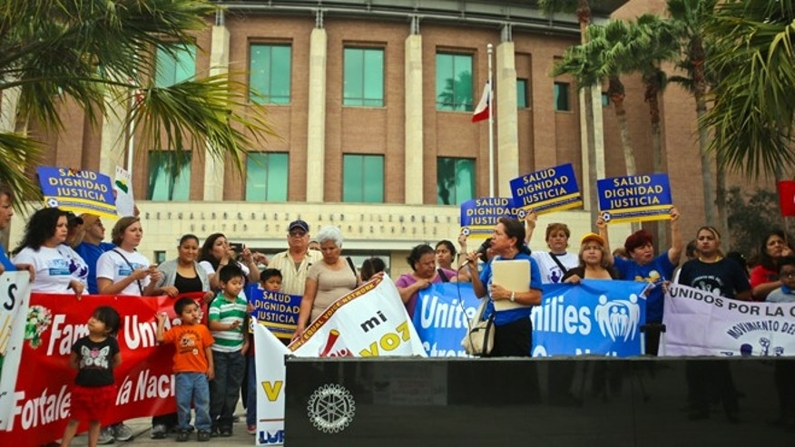 Various human rights organizations gathered outside the federal courthouse in Brownsville, Texas, Thursday, March 19, 2015.  The Justice Department might face sanctions if a federal judge determines its attorneys misled him about whether part of President Barack Obama's executive action on immigration was implemented prior to it being put on hold by the judge. U.S. District Judge Andrew Hanen last month halted Obama's plan. The president's plan would spare from deportation up to 5 million people in the U.S. illegally. (AP Photo/The Brownsville Herald, Yvette Vela)