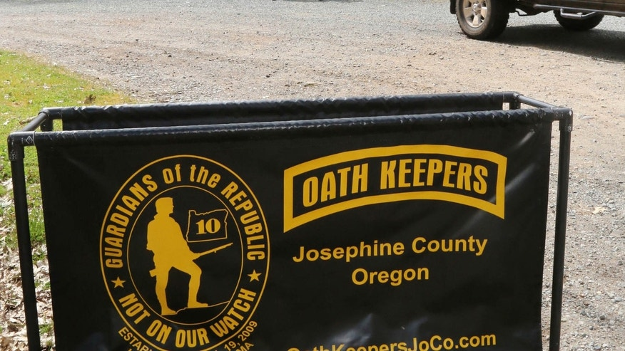 April 14, 2015: An Oath Keepers, constitutional activists, sign marks the entrance to a property on Camp Joy Road near Merlin, Ore