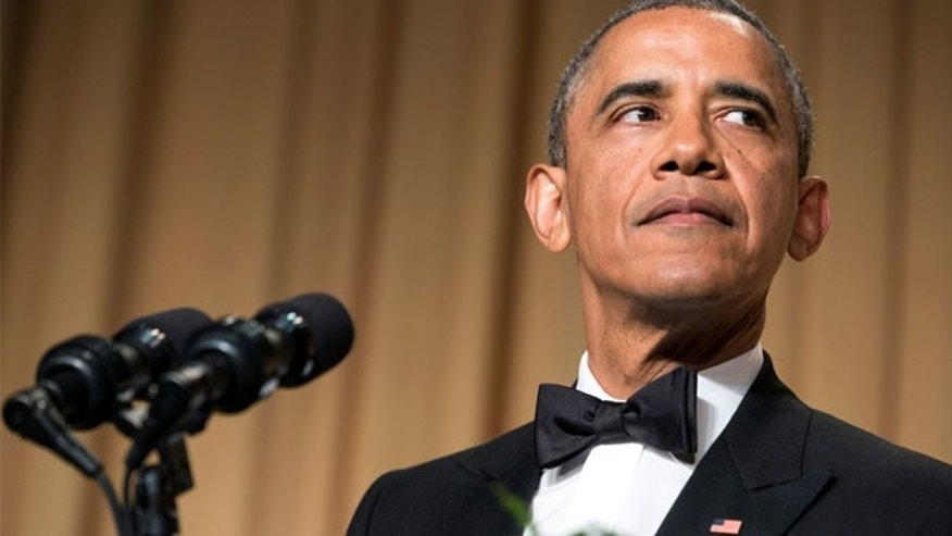FILE: May 5, 2014: President Obama at the annual White House Correspondents' Association dinner, in Washington, D.C.