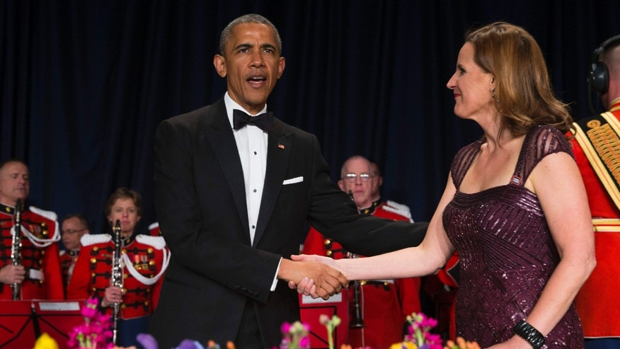 April 25, 2015: President Barack Obama, left, is greeted by White House Correspondents Association president Christi Parsons during the White House Correspondents' Association dinner at the Washington Hilton
