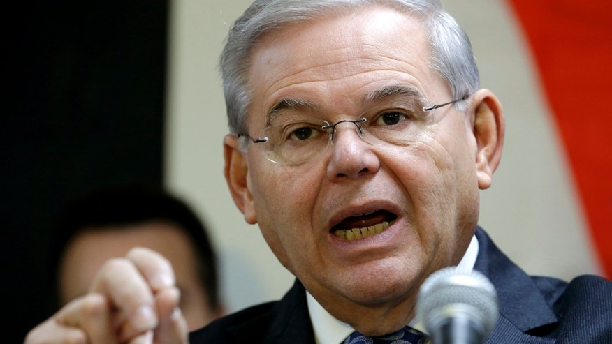 FILE - In this Dec. 5, 2014 file photo, Sen. Robert Menendez, D-N.J. speaks in Secaucus, N.J. Senate proponents of a bill empowering Congress to review and potentially reject any Iran nuclear deal must first win a battle with some colleagues determined to change the legislation in ways that could sink it. âAnybody who monkeys with this bill is going to run into a buzz saw,â Republican Sen. Lindsey Graham of South Carolina warned ahead of this weekâs debate. Also trying to discourage any changes, Democratic Sen. Bob Menendez of New Jersey urged senators to stick with the plan as it emerged from the Senate Foreign Relations Committee.  (AP Photo/Julio Cortez, File)