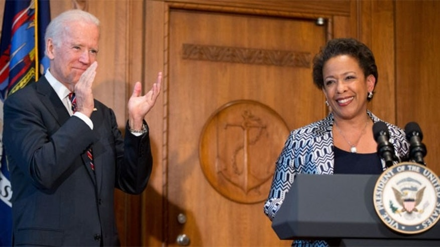 April 27, 2014: Loretta Lynch is sworn in by Vice President Biden as U.S. attorney general, Washington, D.C.