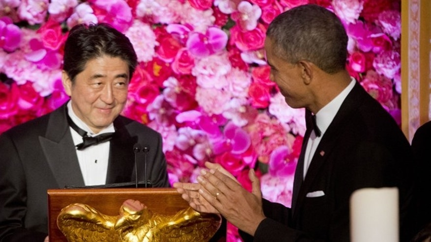 Apr. 28, 2015: President Barack Obama introduces Japanese Prime Minister Shinzo Abe, left, as he host him and Abe's wife Akie Abe, right, at the State Dinner at the White House in Washington.