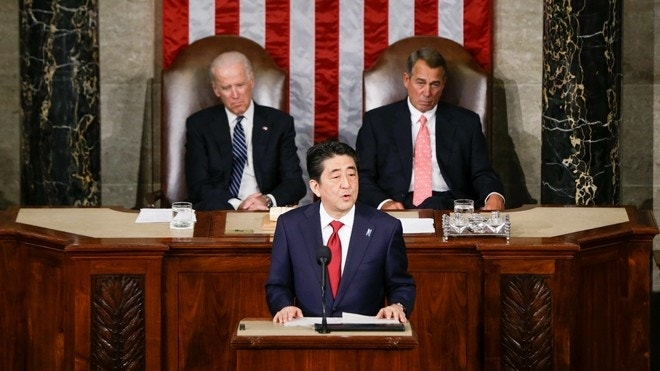 Japanese PM offers 'condolences' for Americans lost in WWII, in speech pushing trade pact