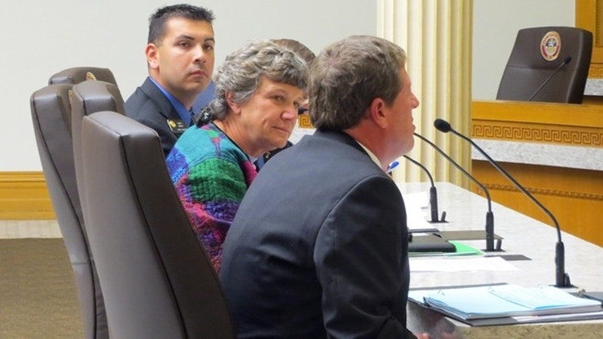 In this April 29, 2015 photo, state Sen. Leroy Garcia, left, one of the sponsors of a bill to change Colorados proxy marriage law to be limited to the military and government contractors, participates in a hearing at the state Capitol in Denver. Also pictured, middle, is Denver County Clerk Debra Johnson, an at right is El Paso County Clerk Chuck Broerman. The three testified in the Senate Judiciary Committee. (AP Photo/Kristen Wyatt)