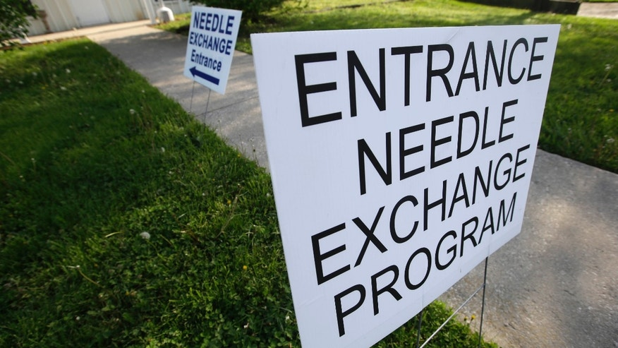 April 21, 2015: Signs are displayed for the needle exchange program at the Austin Community Outreach Center.