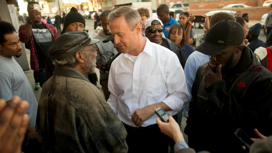 April 28, 2015: Former Maryland Gov. Martin O'Malley, center, meets with residents in Baltimore, Md.