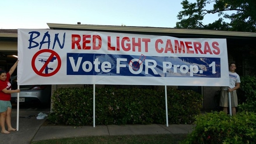 Anti-traffic camera protesters are seen demonstrating in Arlington.