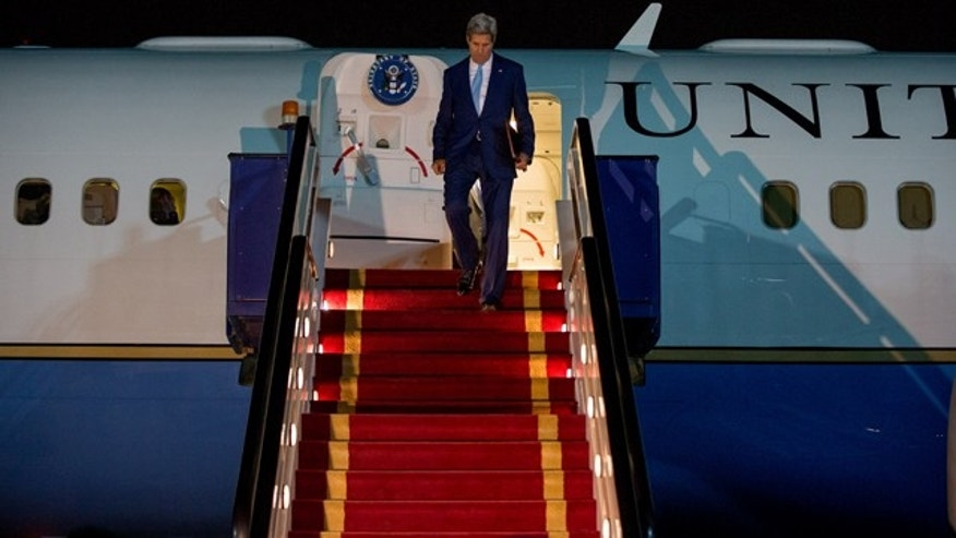 May 6, 2015: U.S. Secretary of State John Kerry arrives at Riyadh Air Base in Saudi Arabia to push Saudi officials for a pause in Yemen's war, citing increased shortages of food, fuel and medicine that are adding to a crisis that already has neighboring countries bracing for a mass exodus of refugees. (AP Photo/Andrew Harnik, Pool)