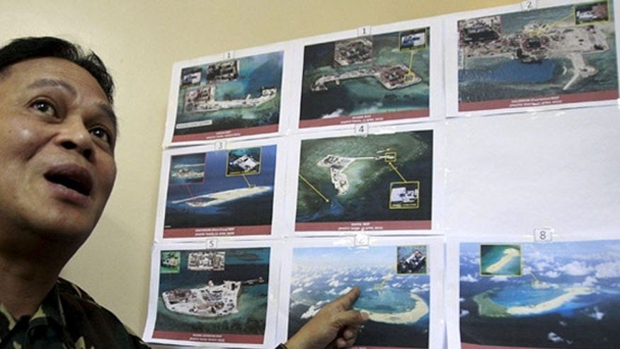 April 20, 2015: A top official with the Armed Forces of the Philippines shows some images of the structures being built by China in the South China Sea.