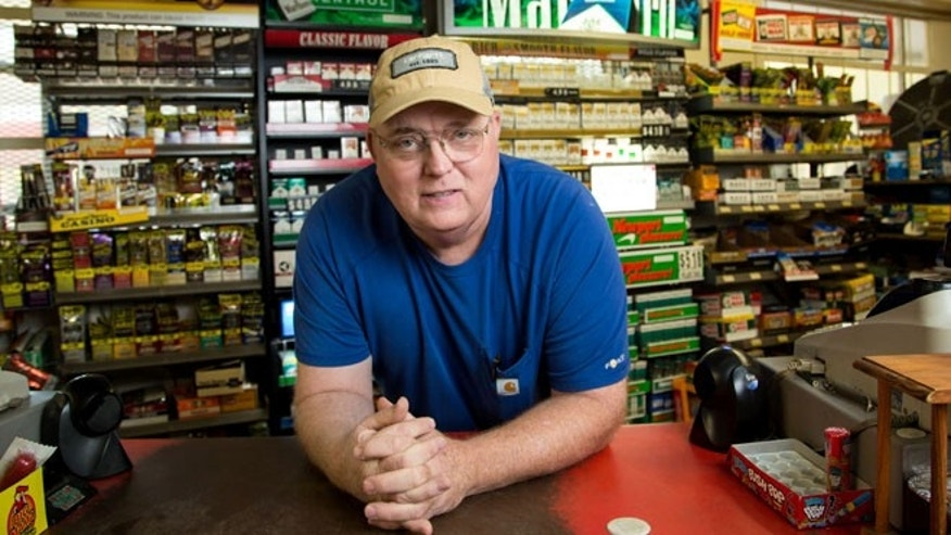 Businessman Lyndon McLellan stands in front of his store L&M Convenience Mart in Fairmont, N.C.