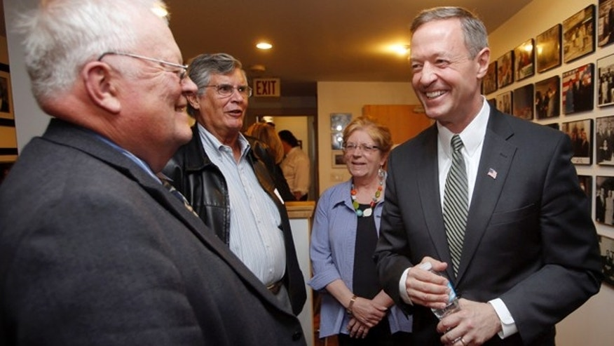 May 13, 2015: Former Maryland Gov. Martin O'Malley, right, talks with New Hampshire State Rep. Bob Backus, left, and former State Sen. Peter Burling before a private meeting with New Hampshire Democrats in Concord, N.H. (AP Photo/Jim Cole)