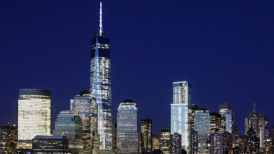 May 6, 2015: A mostly illuminated One World Trade Center towers over the lower Manhattan skyline in New York.