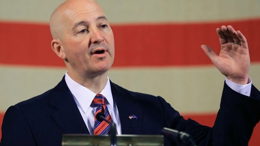 May 20, 2015: Neb. Gov. Pete Ricketts gestures during a news conference in Lincoln, Neb, (AP)