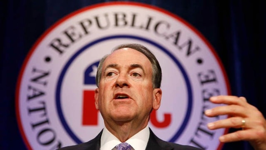 May 15, 2015: Republican presidential candidate and former Arkansas Gov. Mike Huckabee speaks at the Republican National Committee spring meeting luncheon in Scottsdale, Ariz.  (AP Photo/Ross D. Franklin)