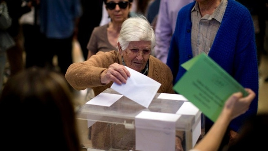Natividad, 97, casts her vote at a polling station in Barcelona, Spain, Sunday, May 24, 2015. Voters began casting their ballots across much of Spain early Sunday in local elections that could see two upstart parties end ntarly four decades of dominance by the conservative Popular Party and the center-left Socialists. (AP Photo/Emilio Morenatti)