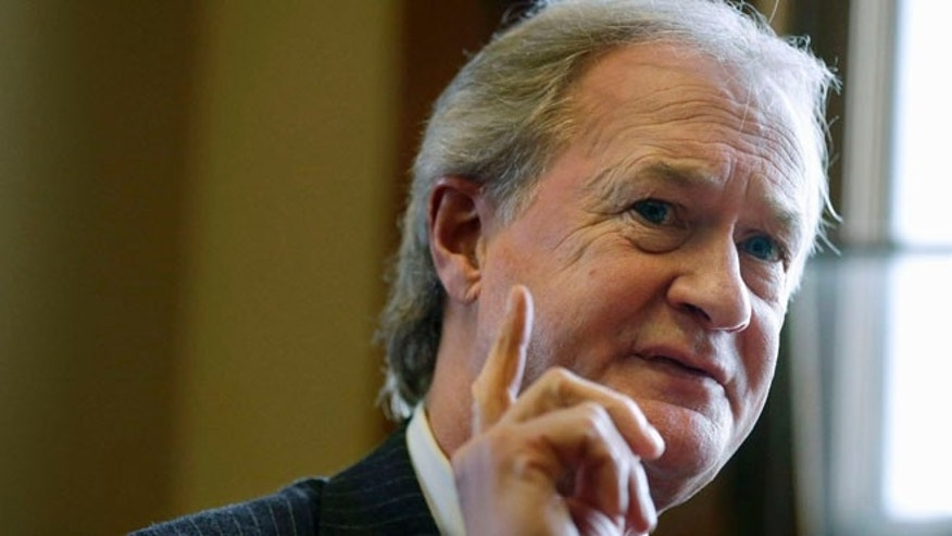 Dec. 11, 2014: Rhode Island Gov. Lincoln Chafee responds to questions during an interview with The Associated Press in his office at the Statehouse, in Providence, R.I.