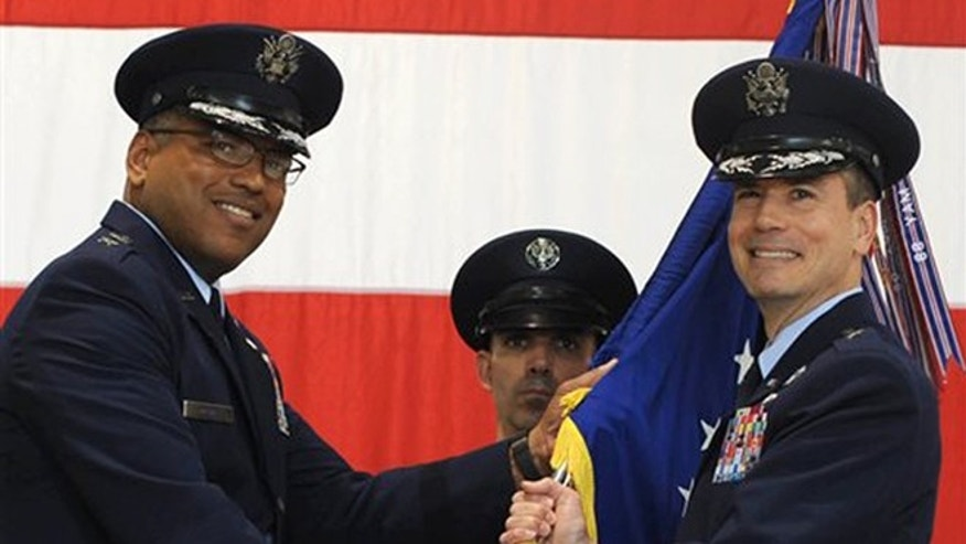 In this photo provided by the U.S. Air Force, Brig. Gen. Paul W. Tibbets IV, right, receives the the 509th Bomb Wing guidon from Air Force Maj. Gen. Richard Clark, left, to take over leadership of the United States' aging fleet of nuclear-capable B-2 stealth bombers at Whiteman Air Force Base, Mo.