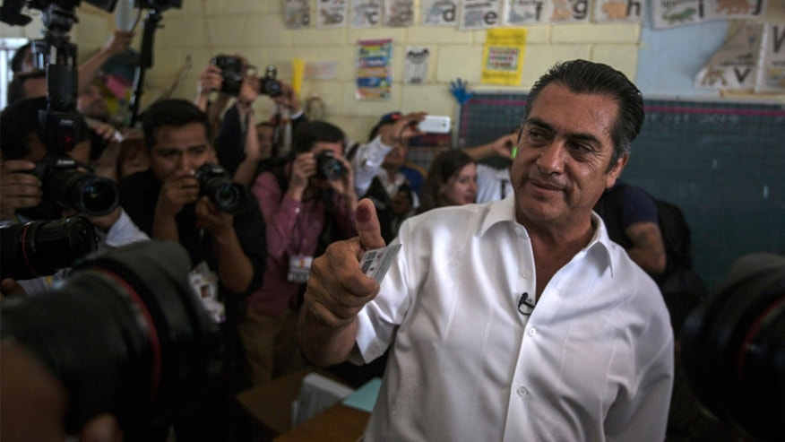 "Jaime Rodriguez, known as ""El Bronco,"" an independent candidate for governor of the northern state of Nuevo Leon, shows his inked finger after casting his vote in Villa de Garcia, Mexico, Sunday, June 7, 2015. Rodriguez, Mexico's first independent gubernatorial candidate, was leading in exit polls as voting closed Sunday. This was the first election in the country allowing unaffiliated candidates, thanks to an electoral reform last year. (AP Photo/Hans-Maximo Musielik)"