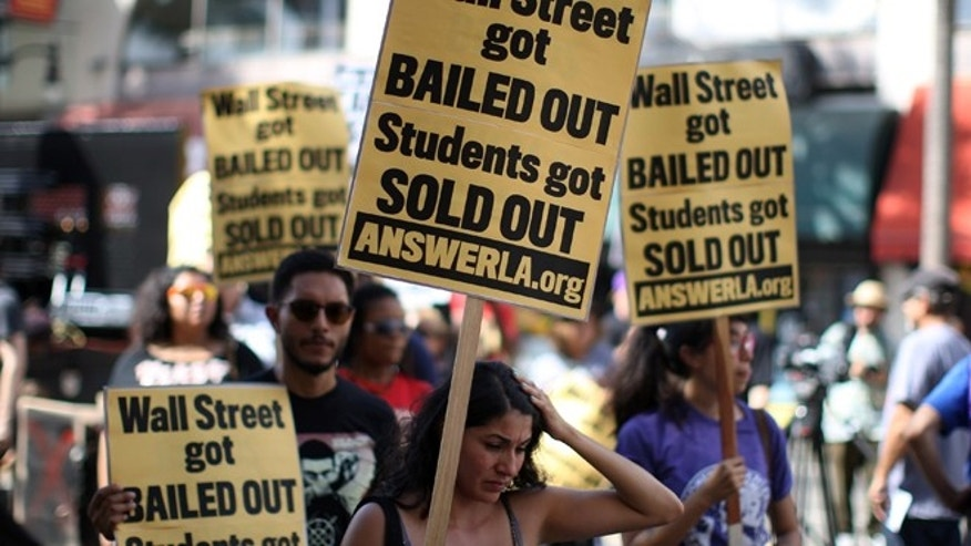 LOS ANGELES, CA - SEPTEMBER 22:  Students protest the rising costs of student loans for higher education on Hollywood Boulevard on September 22, 2012 in the Hollywood section of Los Angeles, California. Citing bank bailouts, the protesters called for student debt cancelations.   (Photo by David McNew/Getty Images)
